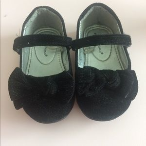 Black ballerina flats with bow